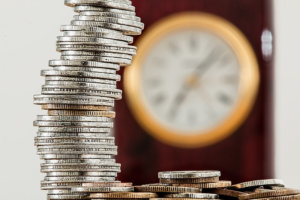 Coins And Clock Image